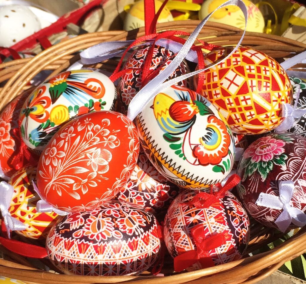 Colourful eggs in a basket depicts Open Air Easter Market Raynham Norfolk